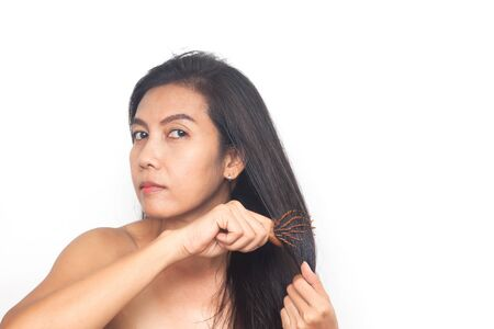 Beautiful of age 40+ Asian woman long black hair on white background. Health and surgery concept Фото со стока