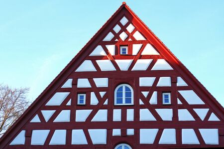 gable of a medieval half-timbered house, restaurated Stock Photo