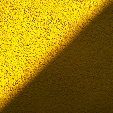 sunlight and shadow on yellow roughcast, diagonal course