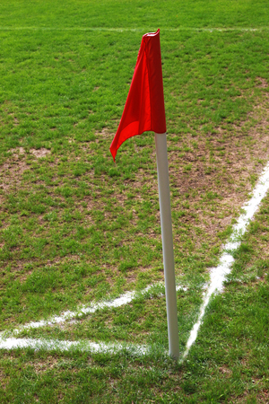 red corner flag on a soccer field Imagens