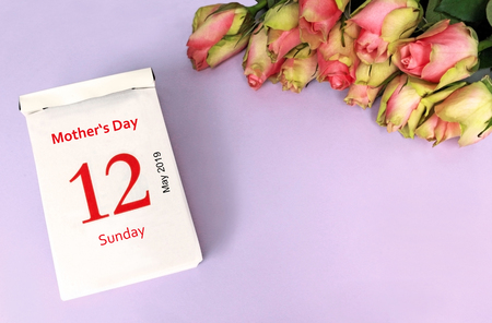 Mother's Day 2019, purple background with calendar date and a bunch of moss roses