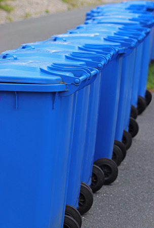 row of garbage cans at the roadside, rear view, close-up