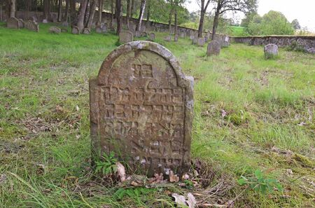 ULLSTADT - 14 JULY 2019 - Jewish cemetery of Ulllstadt, Bavaria, Germany.Weathered sandstone tombstone with Hebrew scriptures on an abandoned rural Jewish cemetery. Used from the 17th century till 193