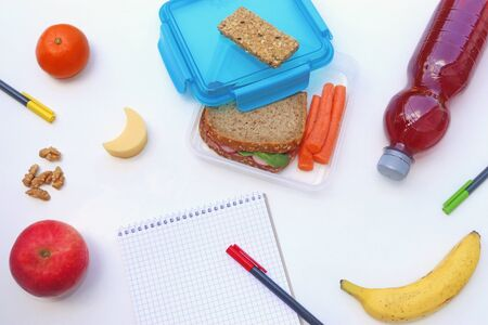 appetizing homemade school lunch with carrot, fruits and nuts