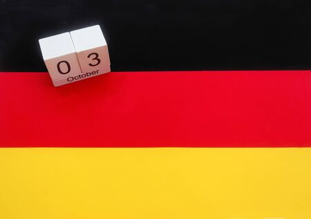 date of the holiday German unity on a German flag, conceptual background