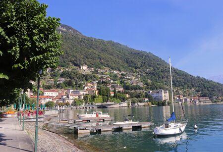promenade at Gravedona, Lake Como, Italy, with moorings and some boats, panoramic view