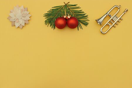 gold colored  christmas or new year background with a frame of christmas ornaments and copy space