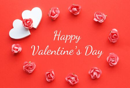 red Valentine greeting card with two hearts and roses