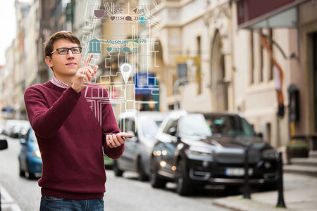 Augmented reality in marketing. Man with phone. Navigation on the projection of the display