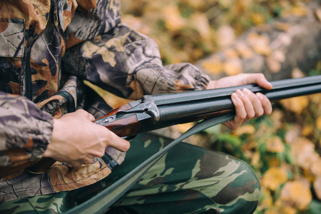 Classic vertical two barrels hunting rifle in hunters hand Stock Photo