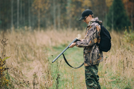 winchester: Hunter with hunting rifle in autumn forest Stock Photo