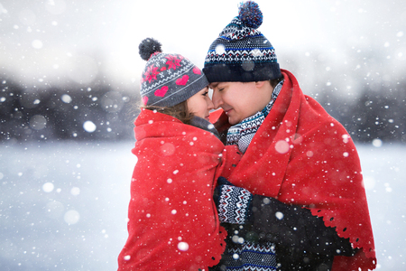 A loving couple walking in winter park. Stock Photo