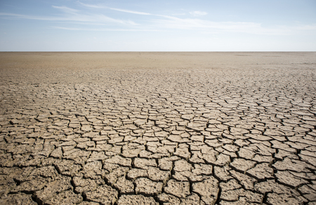Dry cracked desert. Theme of the global shortage of water on the planet. 스톡 콘텐츠