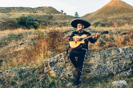 Musician mariachi with guitar on the coast. Stock Photo