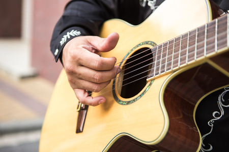 Guitarist plays the guitar. Close-up of hands