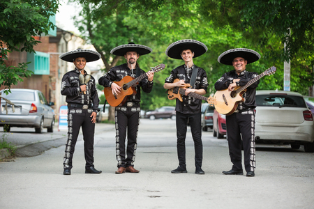 Mexican musicians in traditional costumes mariachi on the streets of the city 스톡 콘텐츠