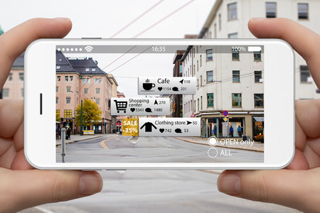 Augmented reality in marketing. Phone in hand, on screen information guide about shopping and entertainment spaces in real time
