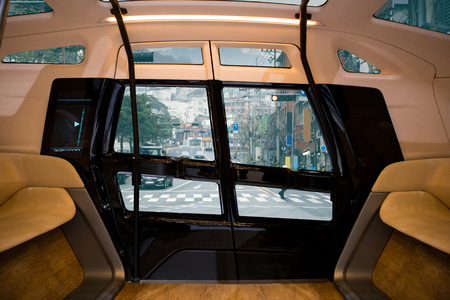 Autonomous self driving smart bus on city street. Inside view