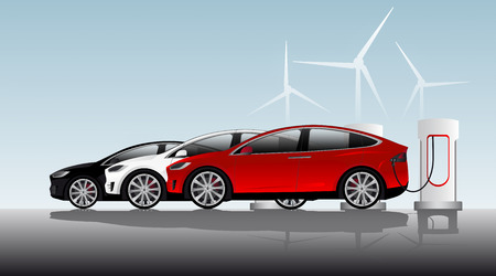 Three electric vehicles are charged at the charging stations against the background of wind generators