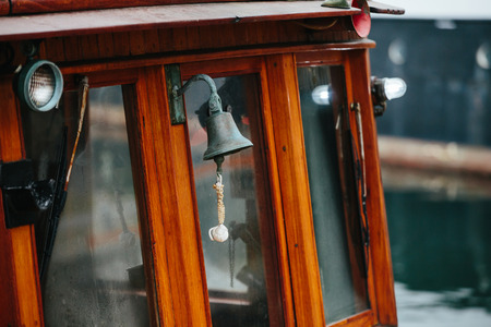 Bell on the deck of an old wooden ship