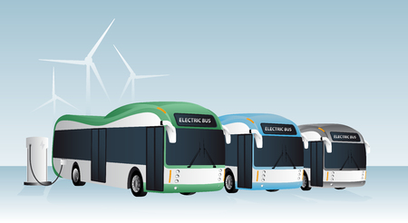 Electric buses are charged at the charging stations. In the background wind generators.