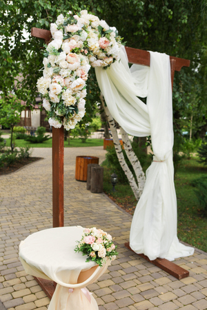Wedding arch decorated with fabric and fresh flowers stock photo stock photo wedding arch decorated with fabric and fresh flowers junglespirit Choice Image