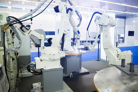 Smart factory. Assembly line with the robotic arms.