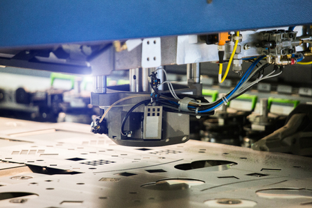 Robot for stamping metal products during work. Modern automated factory 스톡 콘텐츠