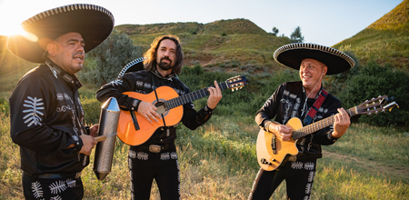 Mexican musicians mariachi in traditional costumes at sunset Stock Photo