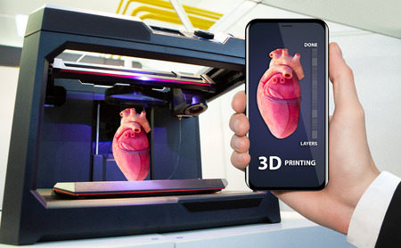 Hand with phone. Application for printing human organs in a 3D printer.