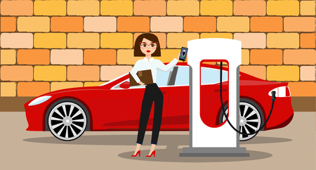 Woman charges an electric car at a charging station for electric vehicles.