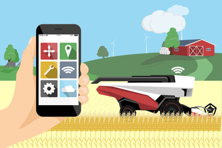 Farmer controls autonomous harvester by phone with mobile app.