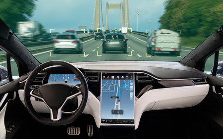 Self driving car on a road. Autonomous vehicle. Inside view. Stock Photo