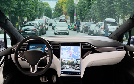 Self driving car on a road. Autonomous vehicle. Inside view. Imagens