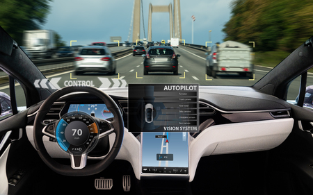 Self driving car on a road. Autonomous vehicle. Inside view. Фото со стока