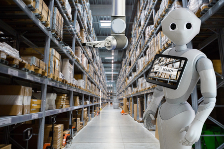 Modern robot with integrated digital tablet and robotic arm in warehouse store stock. Imagens