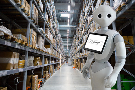 Modern robot with integrated digital tablet in warehouse store stock.