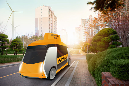 Futuristic autonomous taxi on the city street. Фото со стока