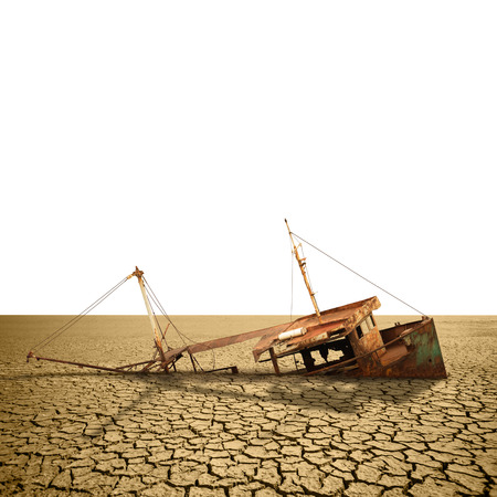 Rusty ship in a dried ocean isolated on white. Template for infographics about global warming and climate change Фото со стока