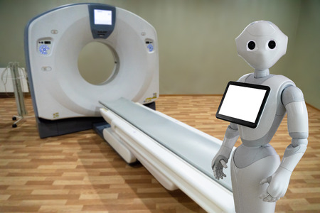 Medical robot on the background of a computer tomograph Фото со стока