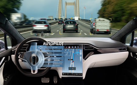 Self driving car on a road. Autonomous vehicle. Inside view.