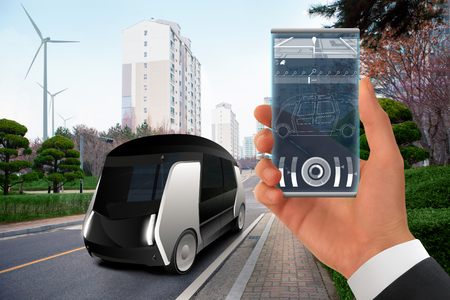 Control of autonomous bus by futuristic smartphone with mobile app . Concept.