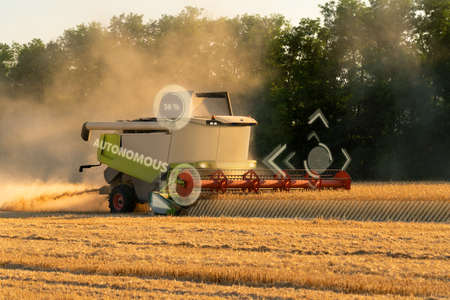 Autonomous harvester on the field. Smart farming concept