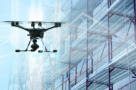 Drone on a background of a construction. Digital transformation and internet of things in construction industry.