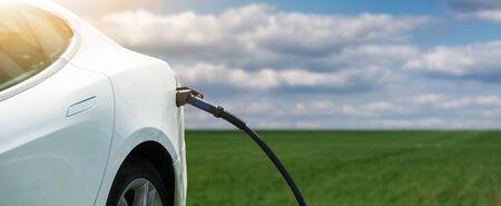 Electric car with charging plug Standard-Bild