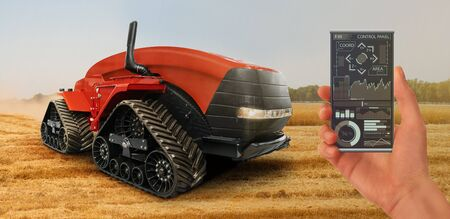 Farmer controls an autonomous tractor