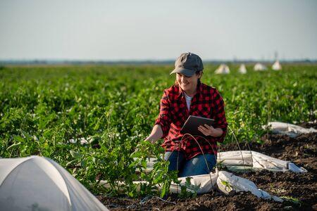 A woman farmer with digital tablet