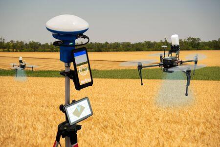 Drone sprayer flies over a wheat field
