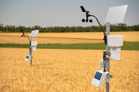 Weather station in a wheat field Foto de archivo
