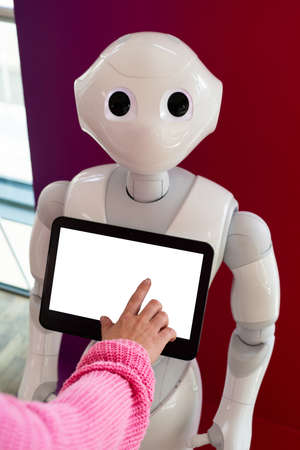 A woman communicates with a robot consultant Stock Photo
